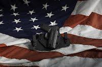 flag with holstered pistol